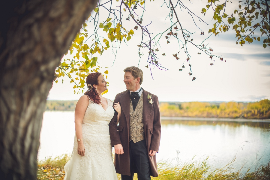 bride groom overlooking lake calgary steampunk wedding photographer anna michalska heritage park