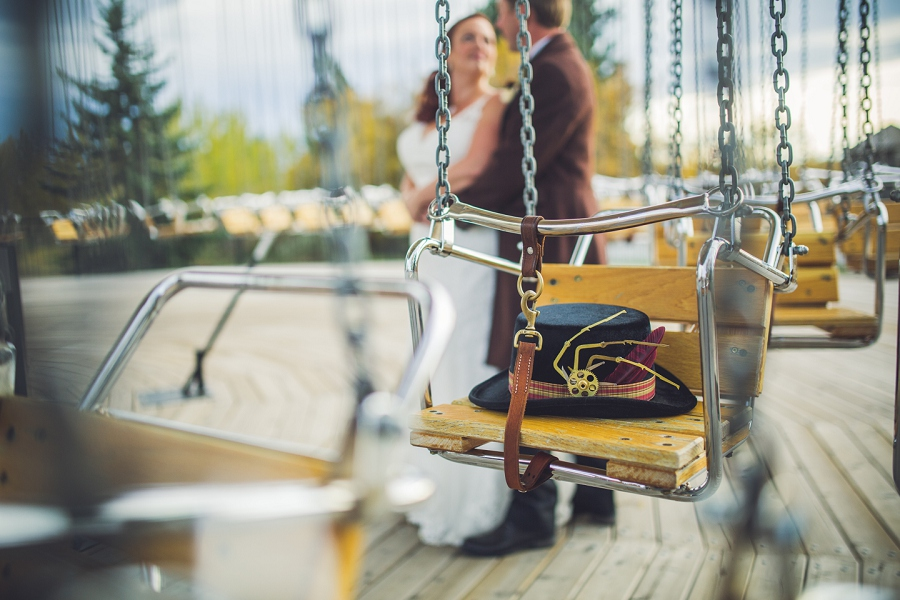 groom bride at swings calgary steampunk wedding photographer anna michalska heritage park