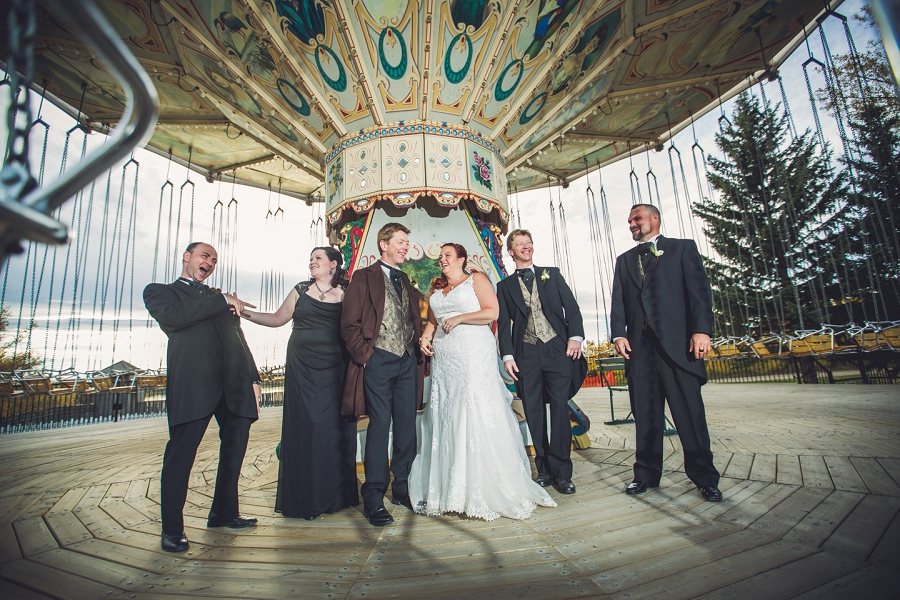 bridal party at swings laughing calgary steampunk wedding photographer anna michalska heritage park