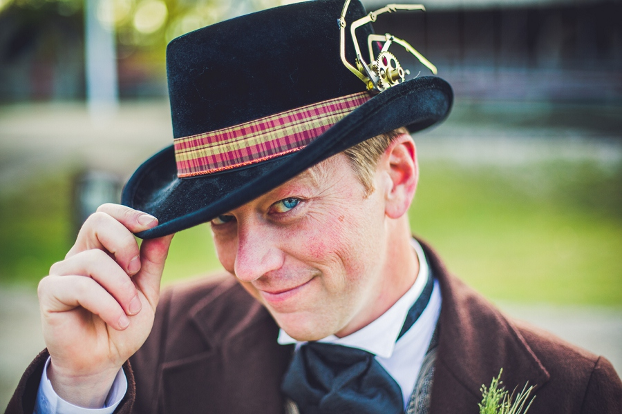 groom tipping hat calgary steampunk wedding photographer anna michalska heritage park