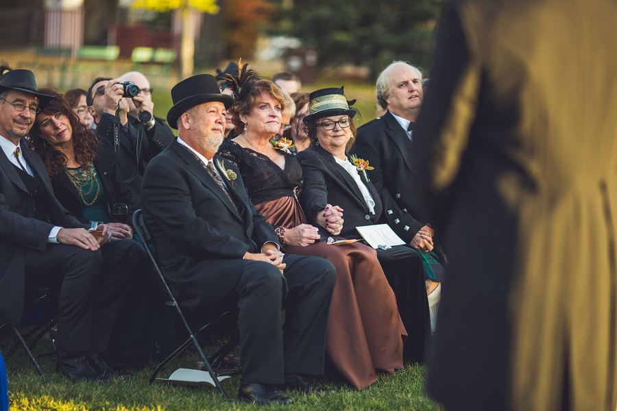 parents watching wedding ceremony calgary steampunk wedding photographer anna michalska heritage park