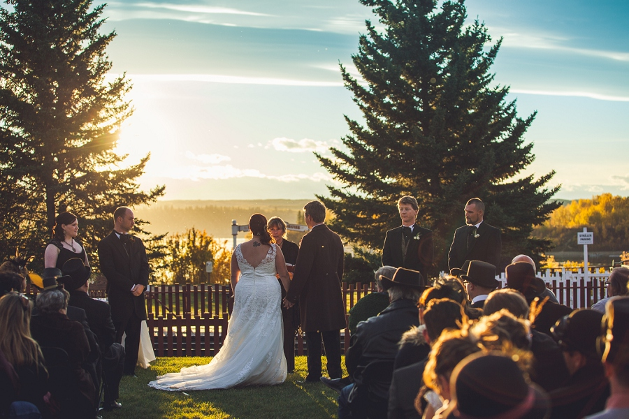 wedding ceremony at sunset calgary steampunk wedding photographer anna michalska heritage park