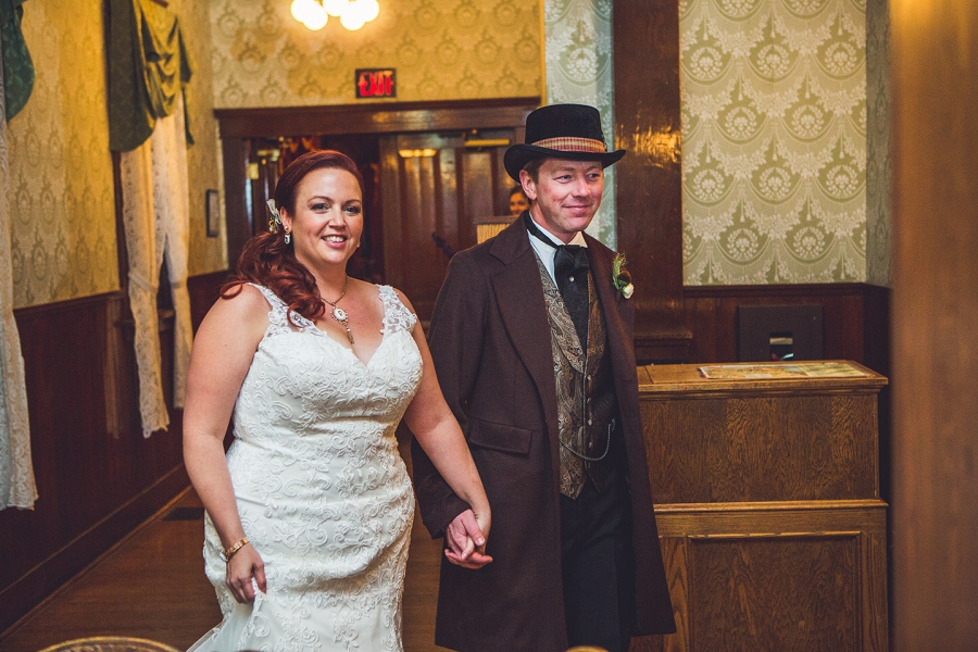 bride groom walking in calgary steampunk wedding photographer anna michalska heritage park