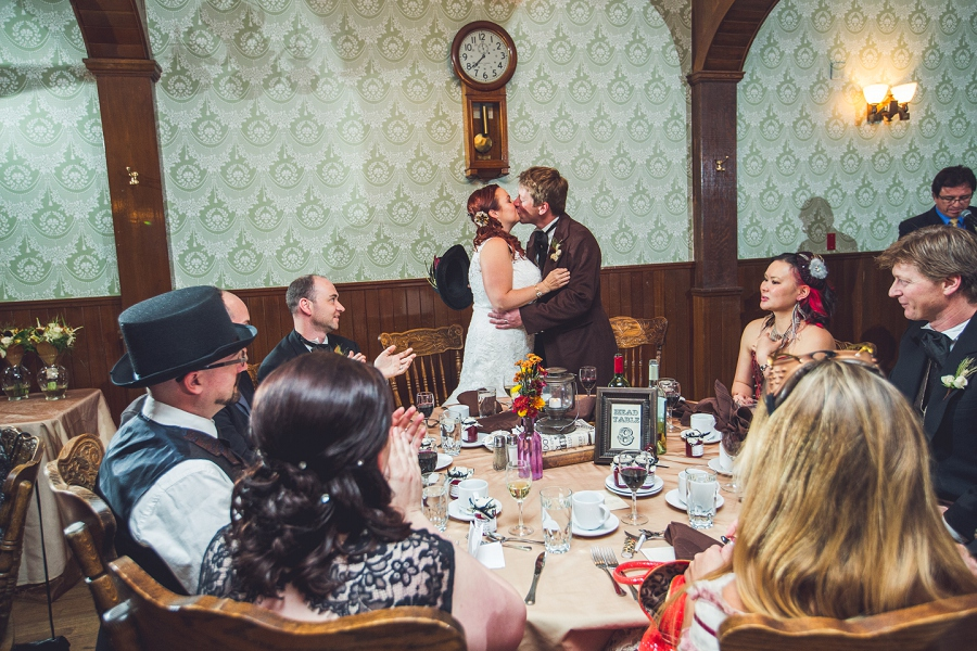 bride groom kissing reception calgary steampunk wedding photographer anna michalska heritage park