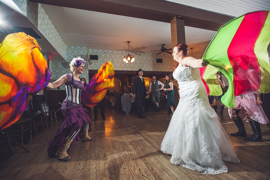 bride dancing with guests streamers calgary steampunk wedding photographer anna michalska heritage park