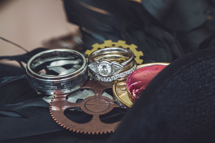 bride and groom wedding rings calgary steampunk wedding photographer anna michalska heritage park