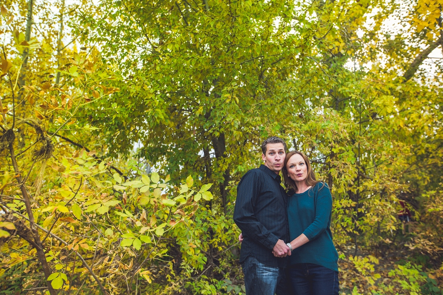 wedding anniversary photography session calgary silly duck faces couple fall trees