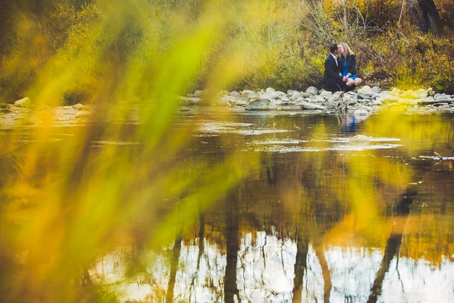 fish creek park calgary engagement photographer anna michalska kiss across river