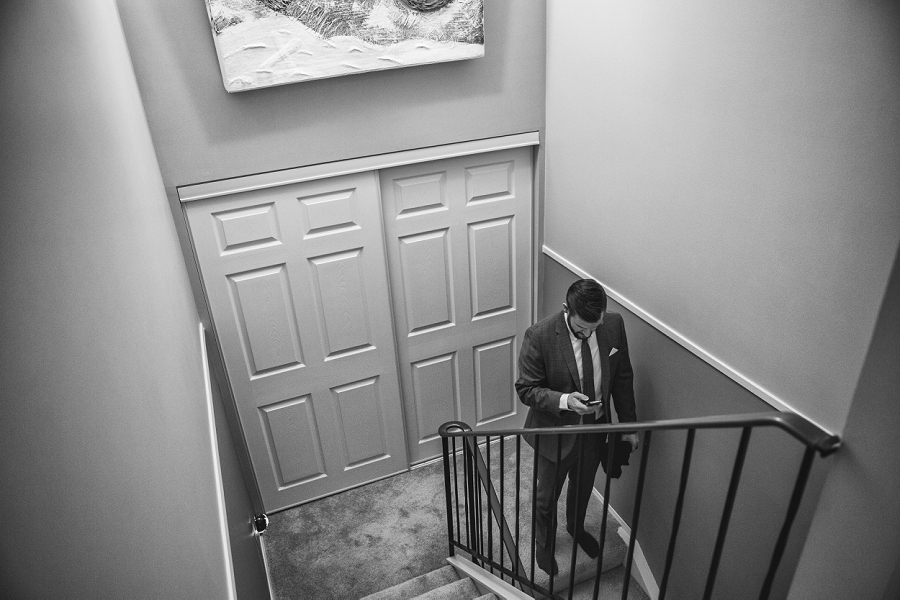 groom on phone at home calgary wedding photographer anna michalska