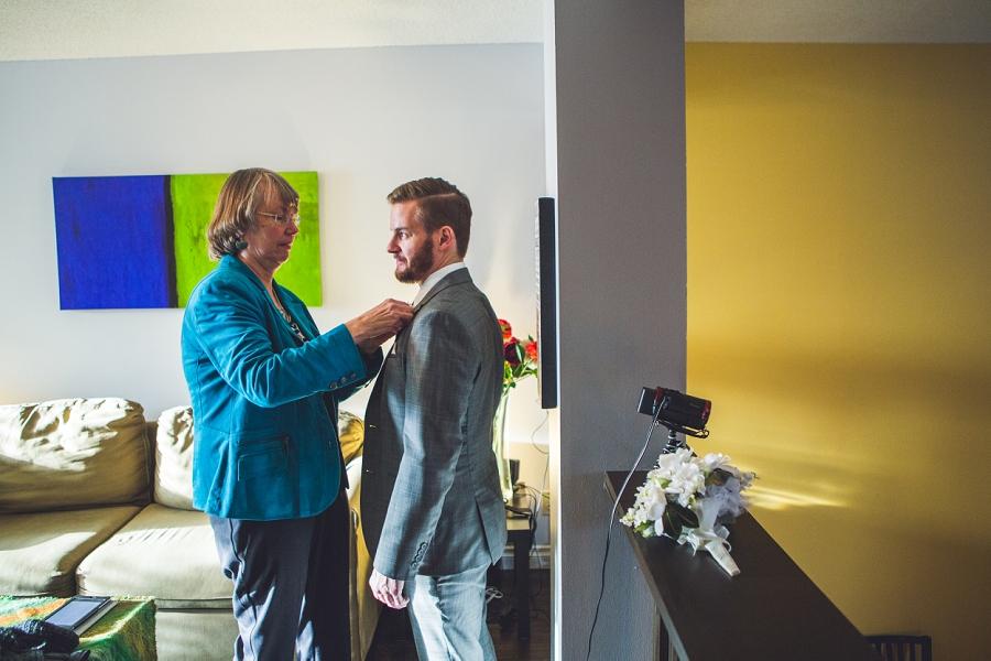 groom getting ready calgary wedding photographer anna michalska