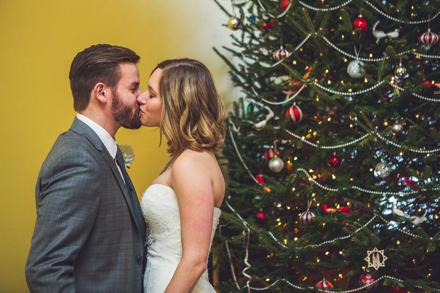 bride and groom kiss christmas wedding calgary wedding photographer anna michalska