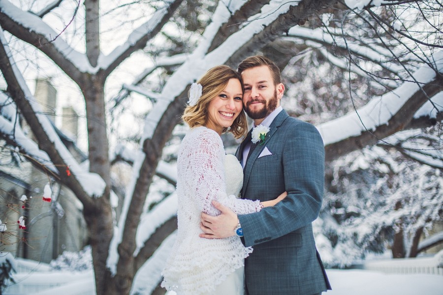 bride and groom snow tree smiling cuddling calgary winter wedding photographer anna michalska