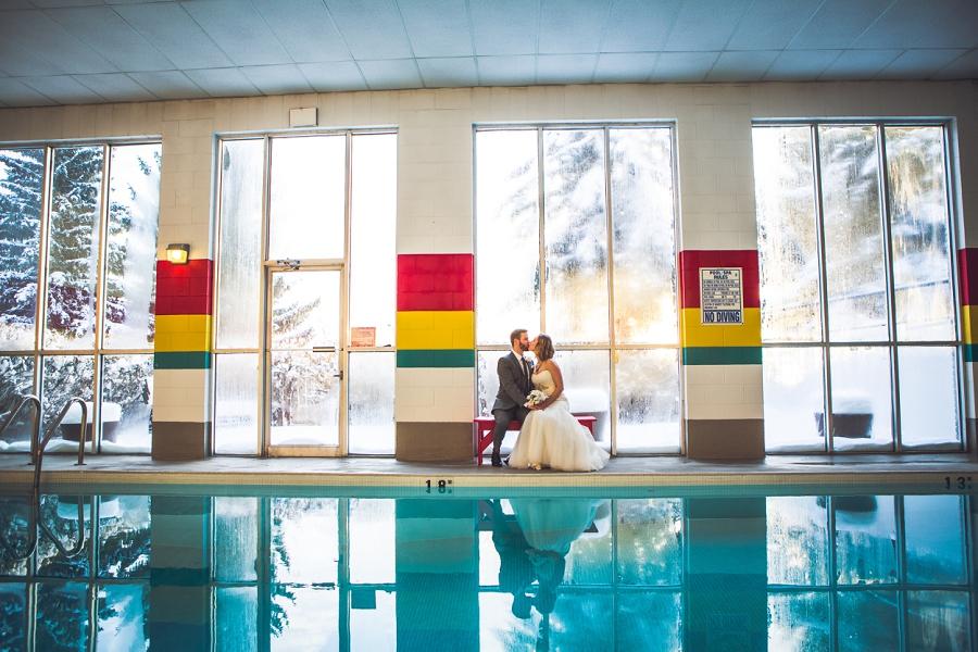 bride groom sitting by condo pool calgary wedding photographer anna michalska