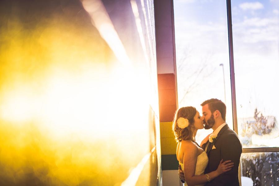 bride groom kissing orange hue pool calgary wedding photographer anna michalska