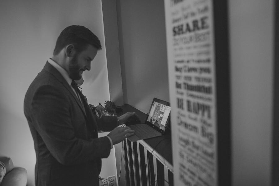 groom setting up skype for wedding calgary wedding photographer anna michalska