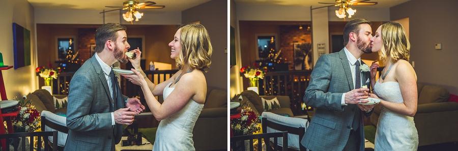 bride and groom eat wedding cake calgary wedding photographer anna michalska
