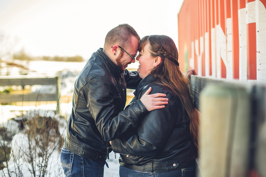 couple at family farm engagement session calgary anna michalska photography