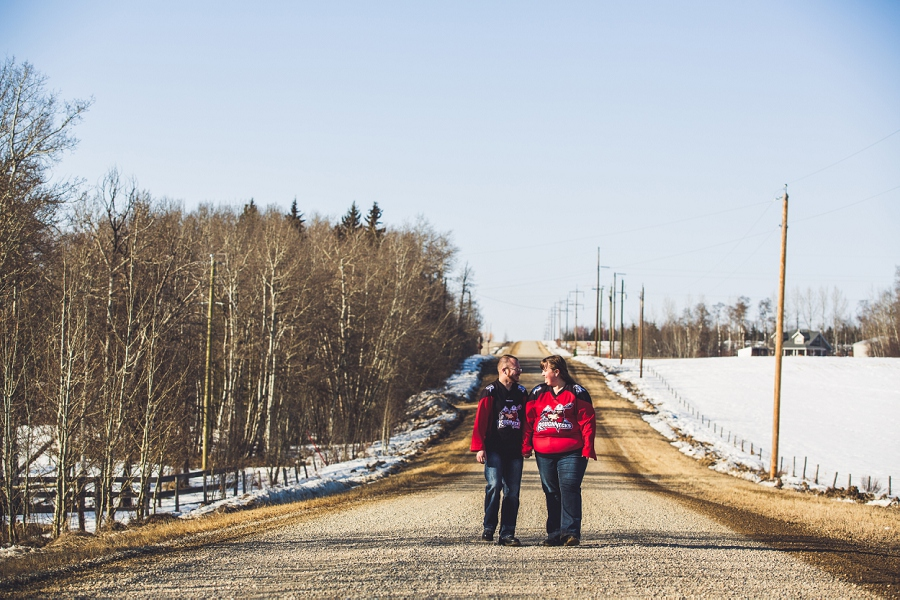 roughnecks jerseys walking down the road couple engagement session anna michalska photography