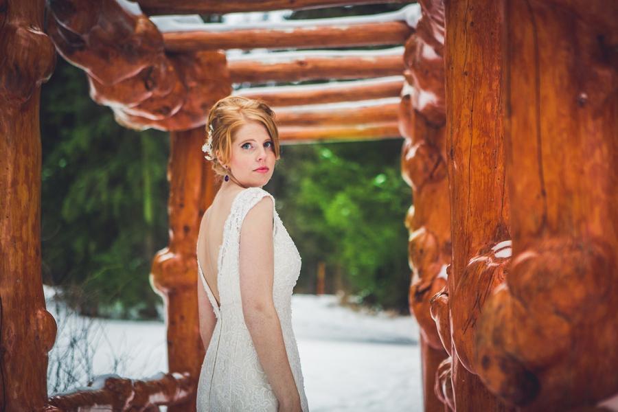 cascade gardens winter wedding bride on wooden bridge anna michalska photography