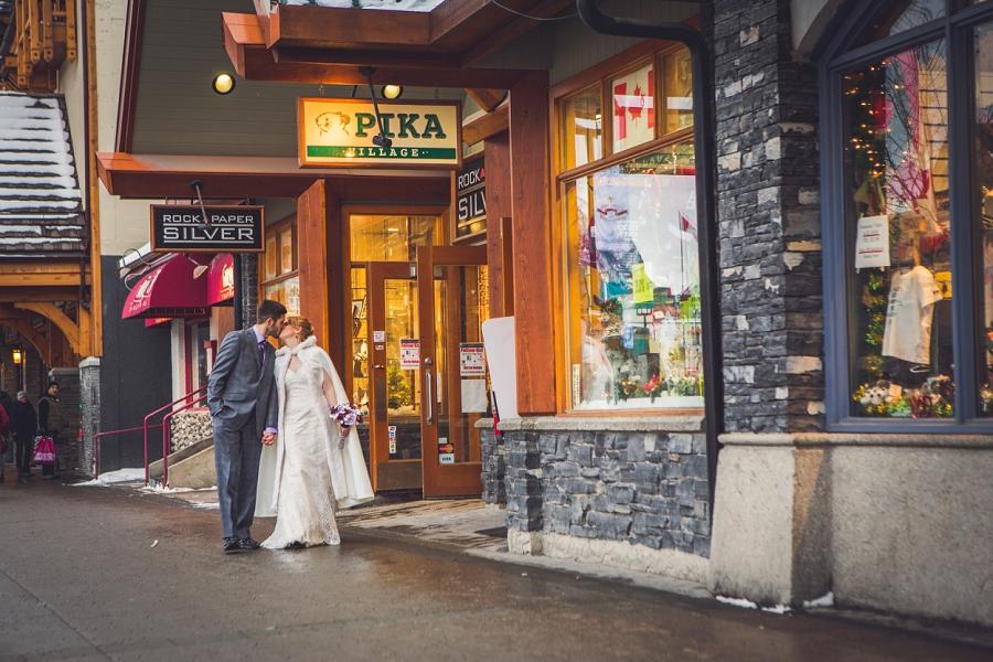 banff avenue downtown winter wedding walking down the street