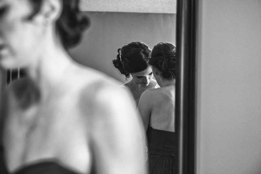 calgary wedding photographer anna michalska bride putting on dress