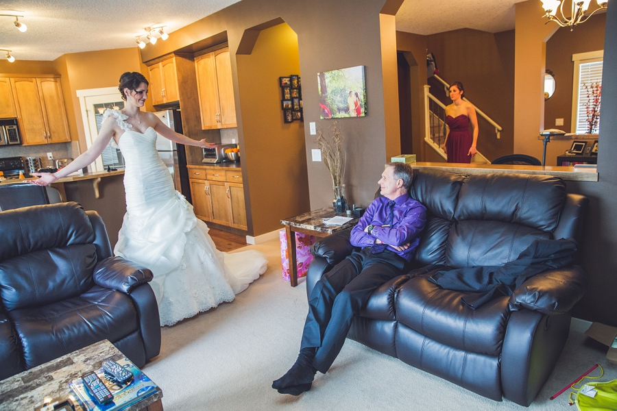 bride getting ready showing father calgary wedding photographer anna michalska