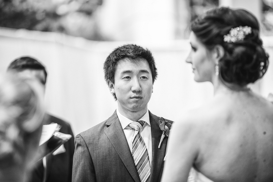 groom looking at bride devonian gardens wedding