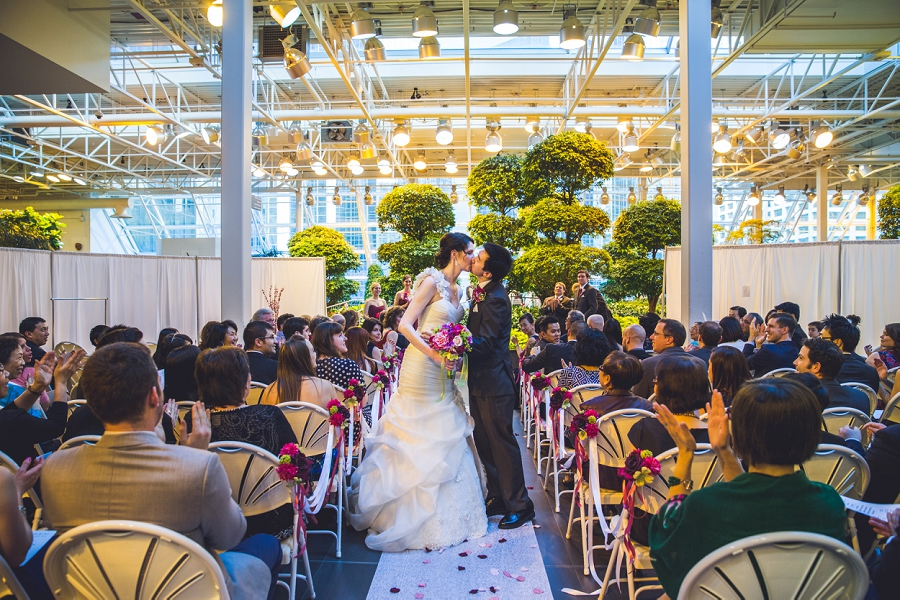 kiss walking up the aisle devonian gardens wedding