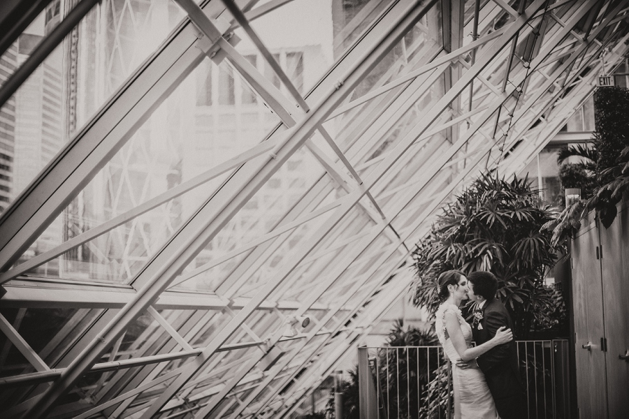 devonian gardens wedding bride groom kiss large window