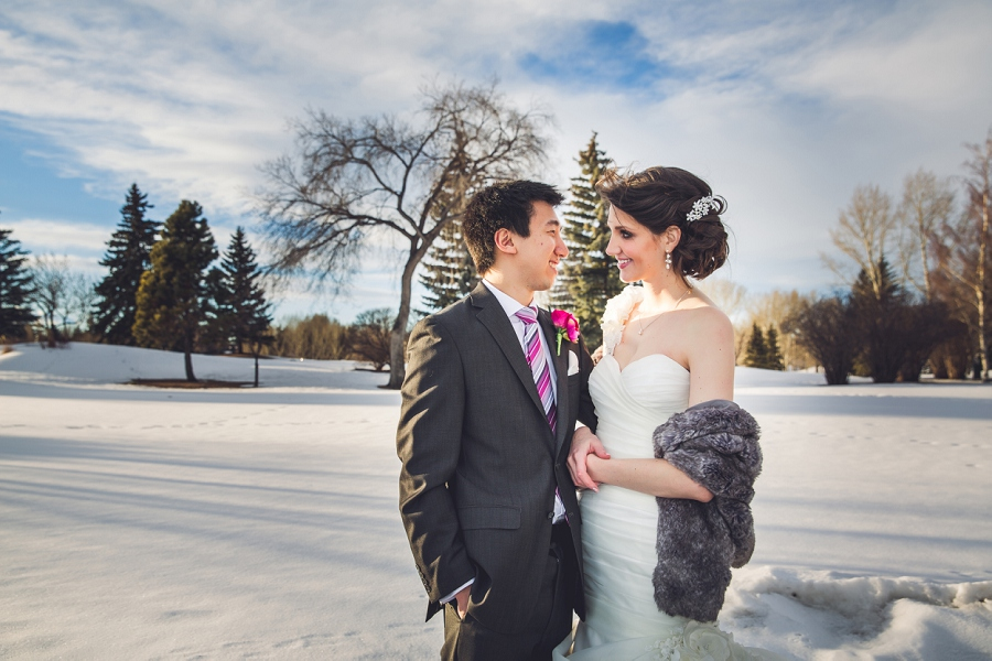 winter bride and groom looking at each other silver springs golf course calgary wedding photographer anna michalska
