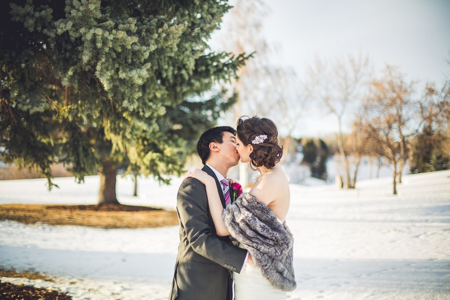 silver springs golf course calgary wedding photographer anna michalska kiss in the snow winter