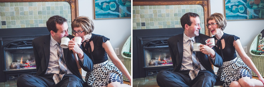 couple enjoying hot cocoa in front of fireplace winter engagement photos calgary anna michalska