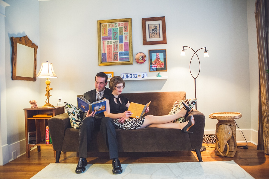 couple reading books at home winter engagement photos calgary anna michalska