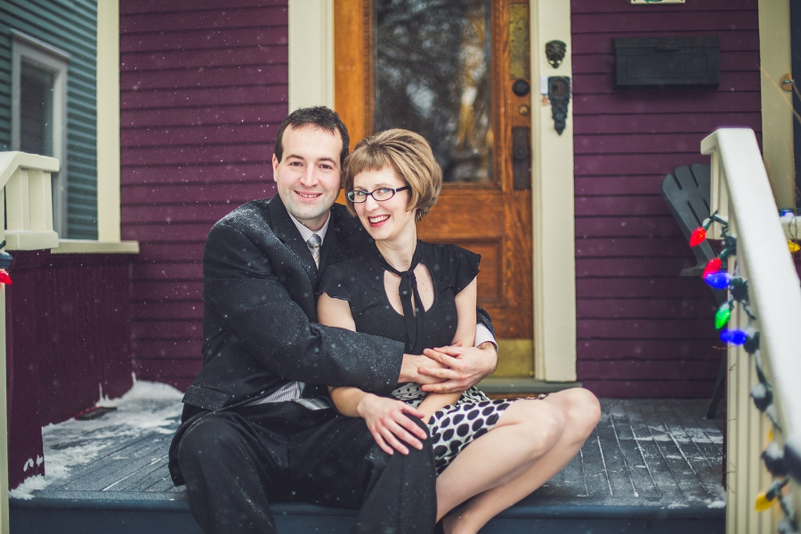 cute couple on front porch winter engagement photos calgary anna michalska