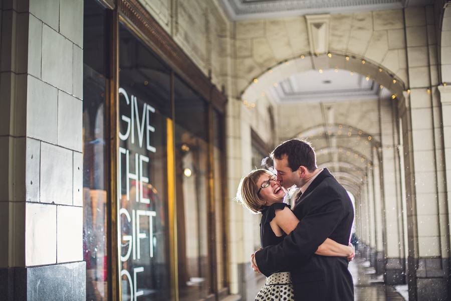 winter engagement photos anna michalska couple kissing downtown the bay