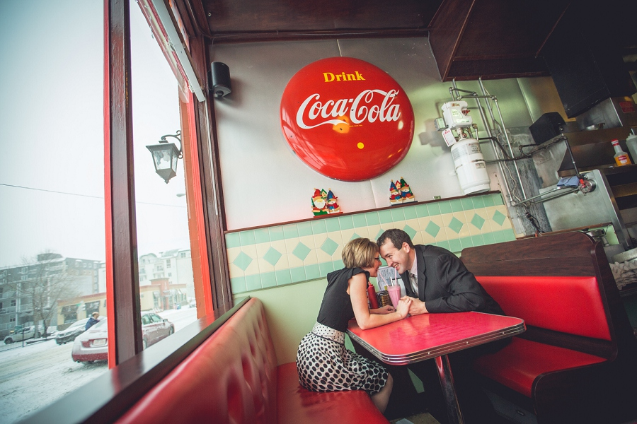 galaxie diner couple sharing milkshake winter engagement photos calgary anna michalska