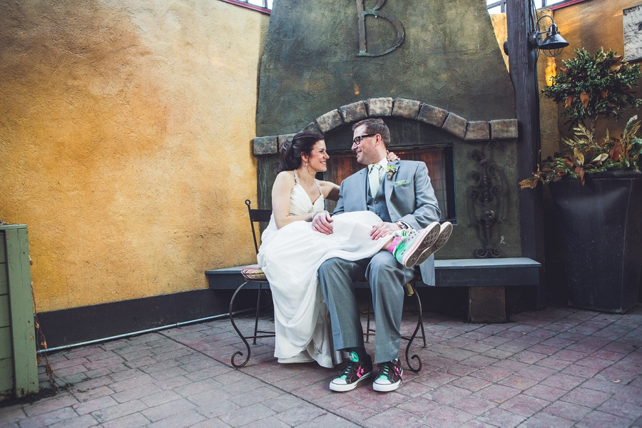 bride groom sitting bonterra trattoria calgary wedding photographer anna michalska