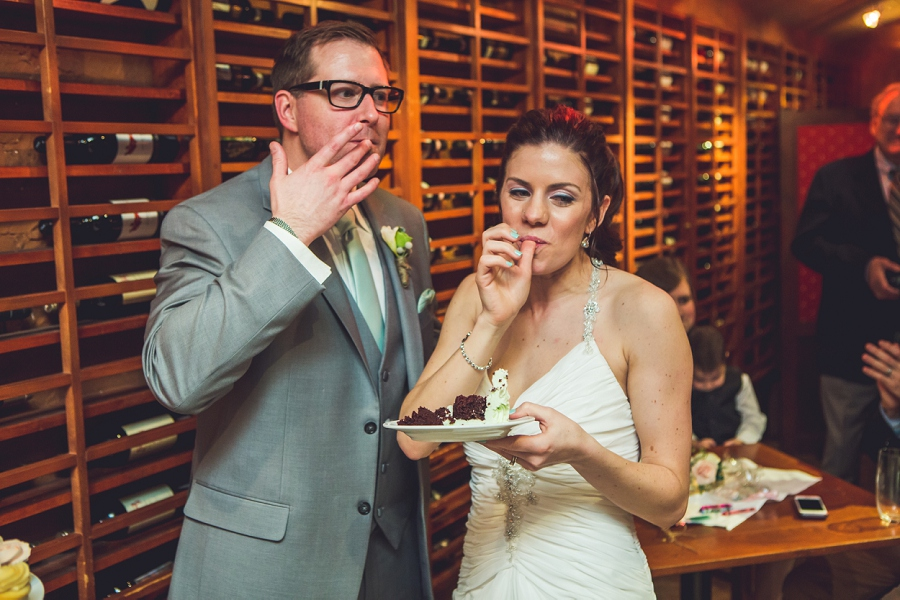 bride groom eat cake bonterra trattoria calgary wedding photographer anna michalska