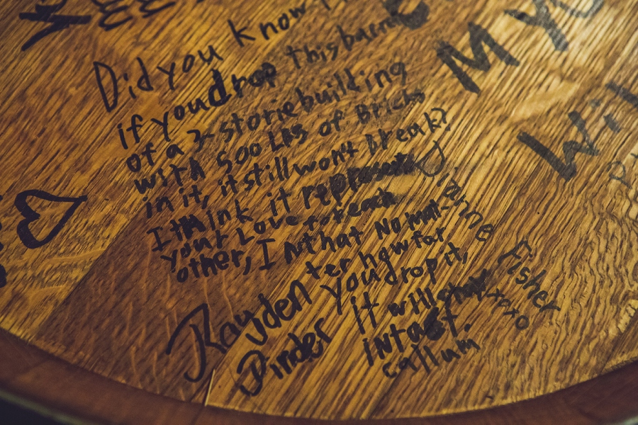 custom wine barrel message from guest bonterra trattoria calgary wedding photographer anna michalska