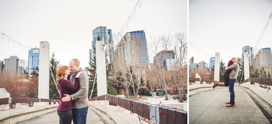 couple on bridge jump hug anna michalska winter engagement session