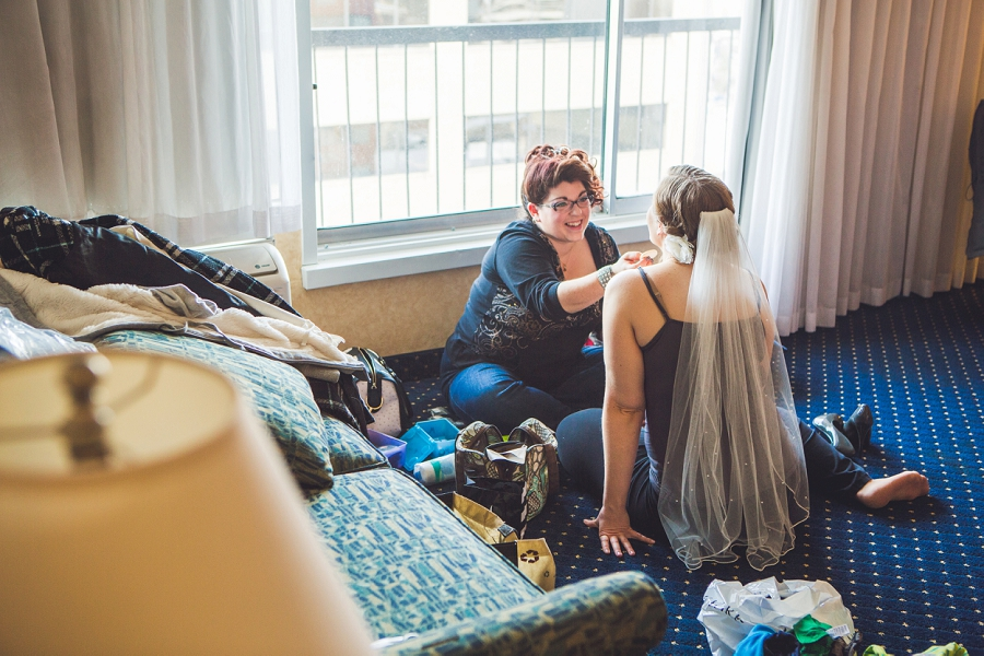 calgary wedding photographer anna michalska best western hotel bride getting ready makeup