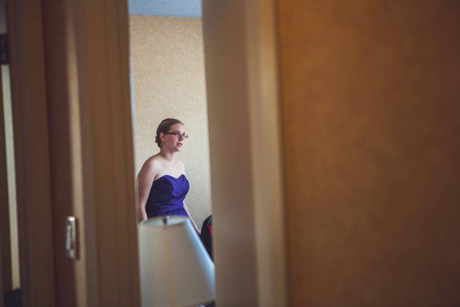 calgary wedding photographer anna michalska best western hotel bridesmaid looking