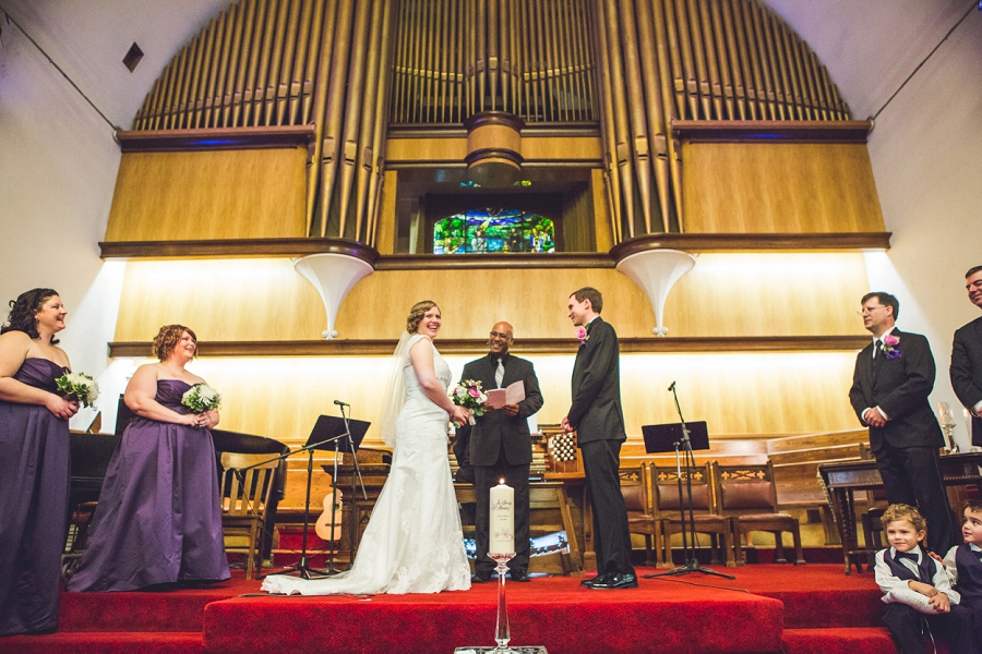 calgary wedding photographer anna michalska first baptist church bride and groom at altar