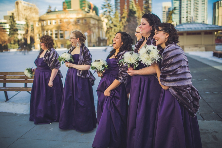 calgary wedding photographer anna michalska winter wonderland central memorial park bridesmaids watching laughing