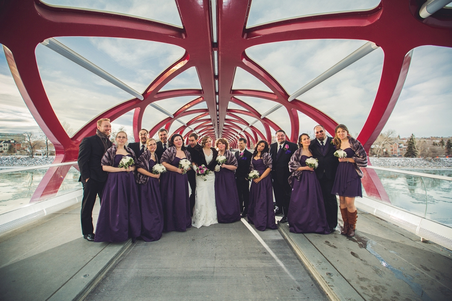 calgary wedding photographer anna michalska winter wonderland peace bridge bridal party silly faces