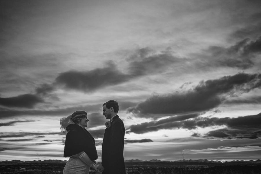 calgary wedding photographer anna michalska winter wonderland peace bridge black and white clouds bride groom