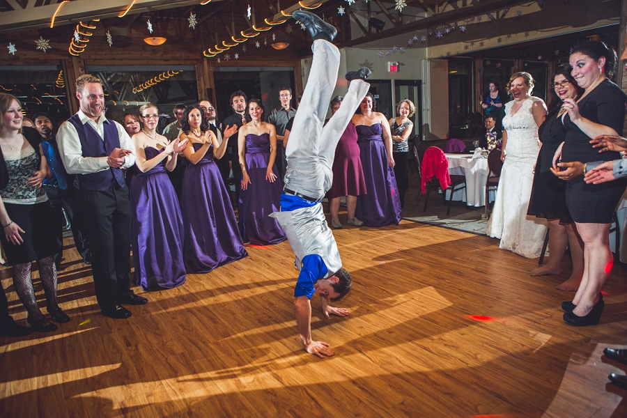 calgary wedding photographer anna michalska winter wonderland pinebrook golf & country club dancing guests handstand