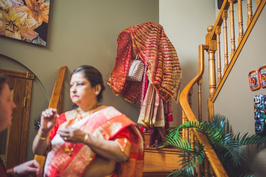 calgary wedding hare krishna anna michalska bride coming down stairs