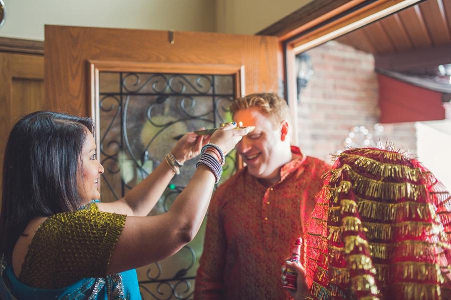 groom being blessed at the door calgary wedding hare krishna anna michalska