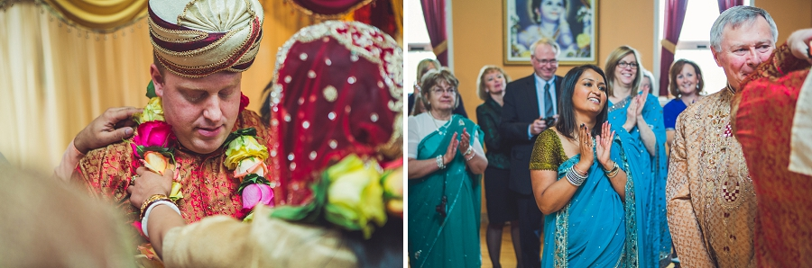 bride presenting flower necklace to groom calgary hindu wedding hare krishna anna michalska
